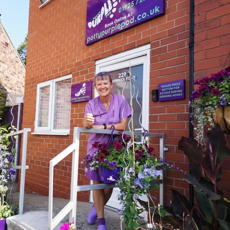Potty Purple Pod Dianne Ashcroft outside her Warrington podiatry clinic